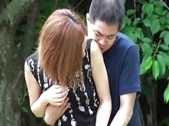 Japanese girl with a dude that got hit with the ugly stick.