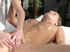 Asiatic masseuse fingering oiled brunette