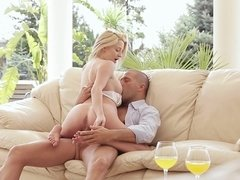 A blonde with a nice pair of tits is having fun with a dude