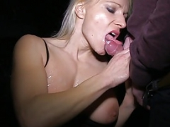Blonde Soccer mom sucking dicks in public