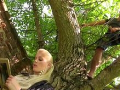 A blonde floozy gets pissed on and fucked hard in the backyard