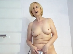 Lovely granny fingered in the kitchen