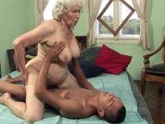 A granny with a sexy body is getting her hairy pussy fucked