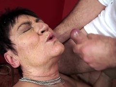 A fat granny is getting her shaved pussy penetrated on the bed