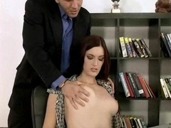 Pretty hot secretary banging a couple of dudes