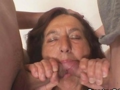 Naughty granny takes two love poles
