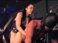 Strapon Domme and Male Slave in BDSM Room