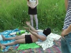 Two guys and girls are having sex outside with a smile