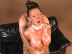 A kinky milf is getting her body oiled up and penetrated
