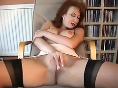 British floozy Red plays with herself in stockings