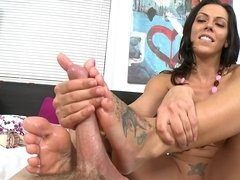 A sexy girl is using her feet and hands on a large erect cock