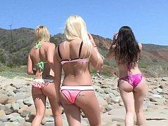 Surfer girls explore the landscape half naked