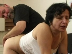 Granny gets her unshaved hole filled with two penises