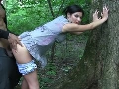 A sexy teen is outside with a guy and is fucking in the forest