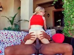 Sensational blonde Penny Pax rides on a large black pecker
