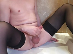 Crossdresser peeing and cumming then showering in stockings