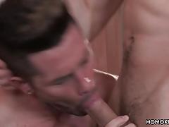 Muscular men having a gay intercourse