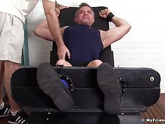 Older dude Brendan Cage is bound to the table and tickled