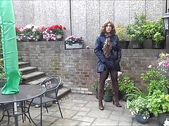 Peeing in chastity, plugged, wearing leopard print boots