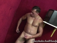Muscular guy sucks a gloryhole BBC and jerks his own dick off