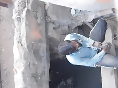 spying indian man peeing near road
