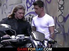 Muscle biker seduced by gay stranger