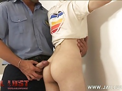 Cuffed delinquent munching on a fat cop meatstick