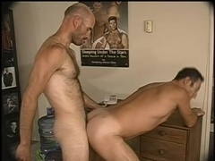 A gay fingers his butt and lets his hairy BF bang it from behind