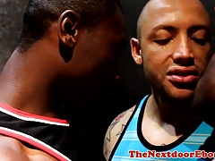 Athletic black hunk spitroasted in ebony trio