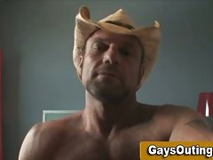 A gay cowboy is jerking himself off