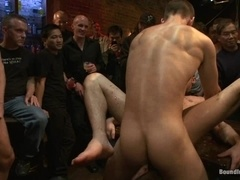 A gay gets his mouth and ass brutally fucked in group BDSM scene