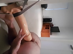 Hot young stud riding huge dildo