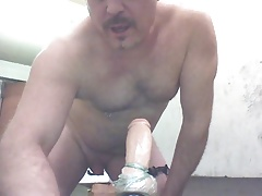 Joey D loving a wide huge dildo in his anal hole