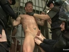 Blonde queer gets banged by a few policemen in a jail