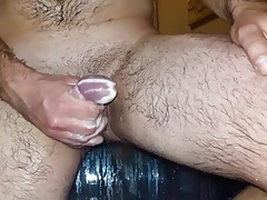 Multiple cumshots in shower (slow motion)
