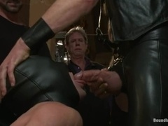 A faggot gets his cock rubbed and his ass slammed by a few dudes