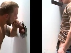 A man gets his dick sucked by a gay in gloryhole reality action