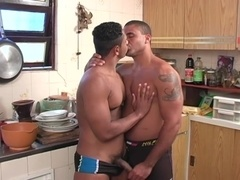 Two muscular studs make gay love in the kitchen after oral sex