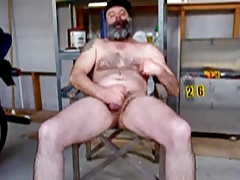 Cigar smoking bear jacking his cock