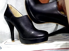 Cum in Black Leather Ankle Boots