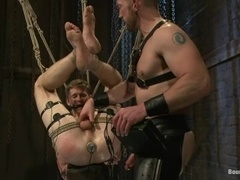 Cole Brooks gets his ass stuffed with a wired dildo in BDSM clip