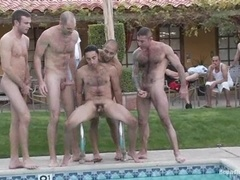 A poofter gets fucked by a few horny dudes on the poolside