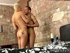 Blonde guy fucked from behind by his tattooed friend
