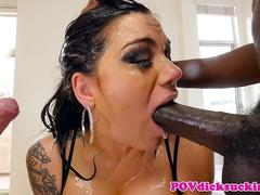 Inked MILF sucks cocks before tasting cum