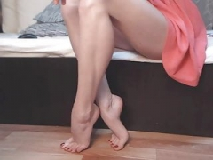 Splendid porn model shows her legs, feet, and besides white mules. Zoom.