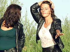 ladies in leather dancing in a sea.