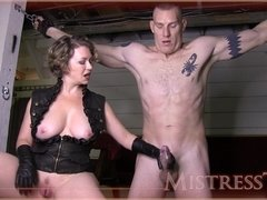 Sexy MILF domina makes her male slave cum