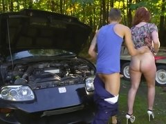 Red-haired cooze is getting her asshole stuffed by the mechanic