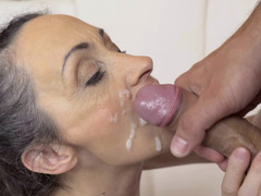 A granny that loves to swallow cum is getting some in her face