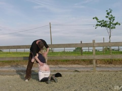 Tina Fleur keeps her riding boots on as her trainer fucks her in the dirt